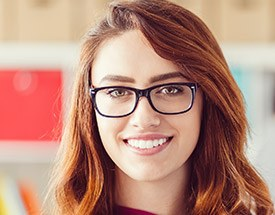 Woman wearing glasses flawless smile