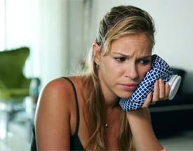 woman getting hit in face with red boxing glove